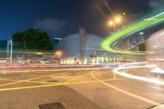 Long exposure captures light trails from passing and turning tra. KOWLOON, HONG KONG - SEPTEMBER 18 2017; Long exposure captures light trails from passing and Royalty Free Stock Images