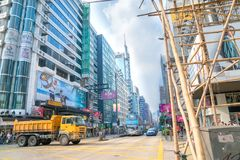 Typically Asian downtown city street  scene with modern building. KOWLOON, HONG KONG - SEPTEMBER 18 2017; Typically Asian downtown city street  scene with modern Royalty Free Stock Image