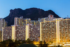 Kowloon with lion rock at night Royalty Free Stock Images