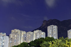 Kowloon residential building with lion rock mountain Stock Image