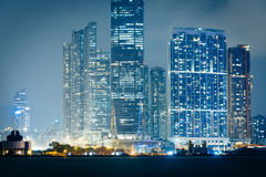 The Kowloon skyline at night, seen from Sheung Wan, in Hong Kong Stock Photos