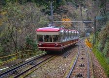 Scenic tram on Mount Koya in Kansai, Japan. Koyasan, Japan - Nov 24, 2016. A red cable car running on rail track to Mt. Koya in Japan. Mount Koya or Koyasan is a Stock Images
