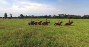 Kozakken op paarden stock afbeelding