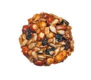 Kozinaki (nationale Georgische zoetheid - noten in honing) is isolat Stock Foto