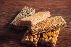 Kozinaki of sesame and peanut on a wooden background Royalty Free Stock Image