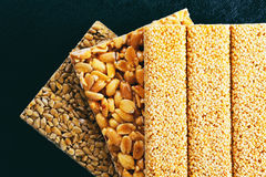 Kozinaki of sunflower, sesame, peanut on a blue background Stock Image