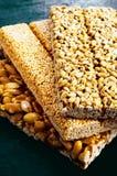 Kozinaki of sunflower, sesame, peanut on a blue background Royalty Free Stock Images