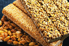Kozinaki of sunflower, sesame, peanut on a blue background Stock Images