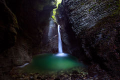 Kozjak Waterfall near Kobarid, Slovenia, Triglav National Park. A waterfall in a dark cave in Triglav National Park Royalty Free Stock Photos