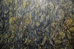 Kozmus granite natural stone tile pattern in abstract color, close up. royalty free stock image