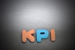 KPI & x28 Βασικοί δείκτης & x29 απόδοσης λέξεις με την ελαφριά εστίαση Στοκ Εικόνες