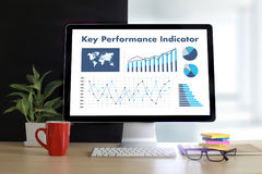 KPI acronym (Key Performance Indicator) Business team hands at w. Ork with financial reports and a laptop Royalty Free Stock Photography