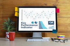KPI acronym (Key Performance Indicator) Business team hands at w Royalty Free Stock Photos