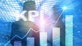 KPI - Graf för indikator för nyckel- kapacitet på suddig bakgrund arkivbild