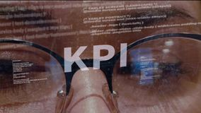 KPI text on background of developer. KPI text on the background of female software developer. Eyes of woman with glasses are looking at programming network code stock footage