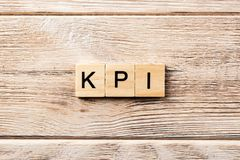 Kpi word written on wood block. kpi text on table, concept royalty free stock image