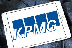 Kpmg logo. Logo of the global network of professional firms providing Audit, Tax and Advisory services, kpmg on samsung tablet Royalty Free Stock Photos