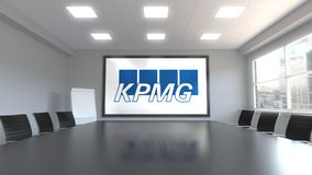 KPMG logo on the screen in a meeting room. Editorial 3D rendering. KPMG logo on the screen in a meeting room. Editorial 3D Royalty Free Stock Photos