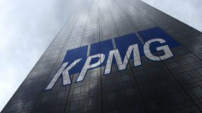 KPMG logo on a skyscraper facade reflecting clouds. Editorial 3D rendering Stock Photography