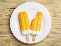 Kräm- isglass för två apelsin Royaltyfri Bild
