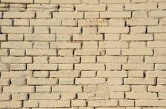Kräm- tegelsten texturerad bakgrund Arkivbild