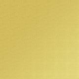 Kräm- texturbakgrund för guld- folie Arkivfoto