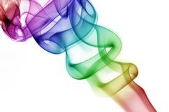Kräuselnregenbogen-Rauch Stockfotos