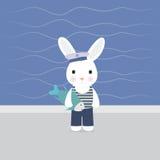 Królika żeglarza chwyty w łapy ryba Zdjęcie Royalty Free