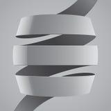 Krökt band för grått tyg på grå bakgrund Royaltyfria Foton