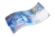 Krökt sedel av de hundra schweizisk franc royaltyfri bild