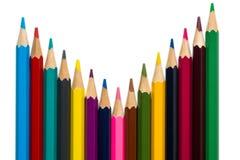 Krökta färgrika blyertspennor på vit bakgrund 2 Arkivbilder