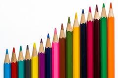 Krökta färgrika blyertspennor på vit bakgrund 1 Royaltyfri Fotografi