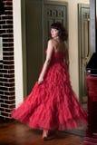 kręcenie drzwiowa czerwona kobieta Zdjęcie Stock