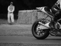KR211V racing motorcycle passes a marshall Stock Image