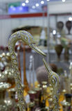 Kraan gouden beeldhouwwerk Stock Fotografie