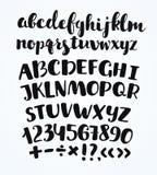 Krabbel typografische symbolen - hand getrokken doopvont over oud geel document Royalty-vrije Stock Foto's