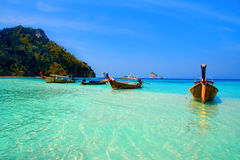 Krabi. Longtailboats tied up in the turquoise waters at Krabi Royalty Free Stock Photography