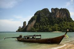 Krabi coastline longtail boat thailand. Longtail boat on beach at krabi thailand Royalty Free Stock Photography