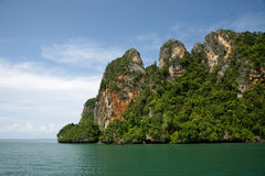 Krabi Island hopping in the afternoon, Thailand. Island filled with green trees in the middle of the sea at Krabi in the afternoon, Thailand Stock Photos