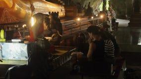 KRABI, THAILAND - DECEMBER 22, 2014: Buddhist monk praying in temple stock footage