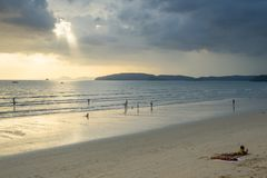 People relax and walking at Ao Nang beach before the sunset Stock Photos