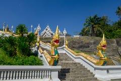 KRABI, THAILAND - FEBRUARY 19, 2018: Naga staircase at Wat Kaew Korawararam public white temple, church in THAILAND. KRABI, THAILAND - FEBRUARY 19, 2018: Naga royalty free stock image