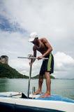 KRABI, THAILAND, NOV 6 : local boatman  dropping an achor in tou Royalty Free Stock Photo