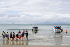 KRABI, THAILAND - OCTOBER 26, 2013: Andaman sea, Ao Nang beach, tourists landing speedboats Royalty Free Stock Photos