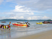 KRABI, THAILAND - OCTOBER 26, 2013: Andaman sea coast,  tourists landing speedboats Royalty Free Stock Photos