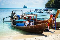 Krabi Thailand. October 2010. Longtail boat and speedboat on the. Beach, on the island of Koh Hong Stock Image