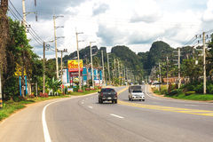 Krabi, Thailand. Streets of the suburb, cars and buildings. Stock Image