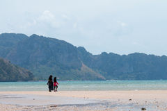 KRABI, THAILAND - women wearing HIJAB walking on the beach on Apr 16, 2014 in Krabi, Thailand Stock Photography