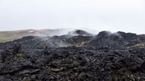 Krafla black hot lava field Leirhnjúkur. Steaming black hot lava on the Leirhnjukur field of the Krafla volcano in Iceland stock photos