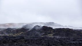 Krafla black hot lava field Leirhnjúkur. Steaming black hot lava on the Leirhnjukur field of the Krafla volcano in Iceland stock images